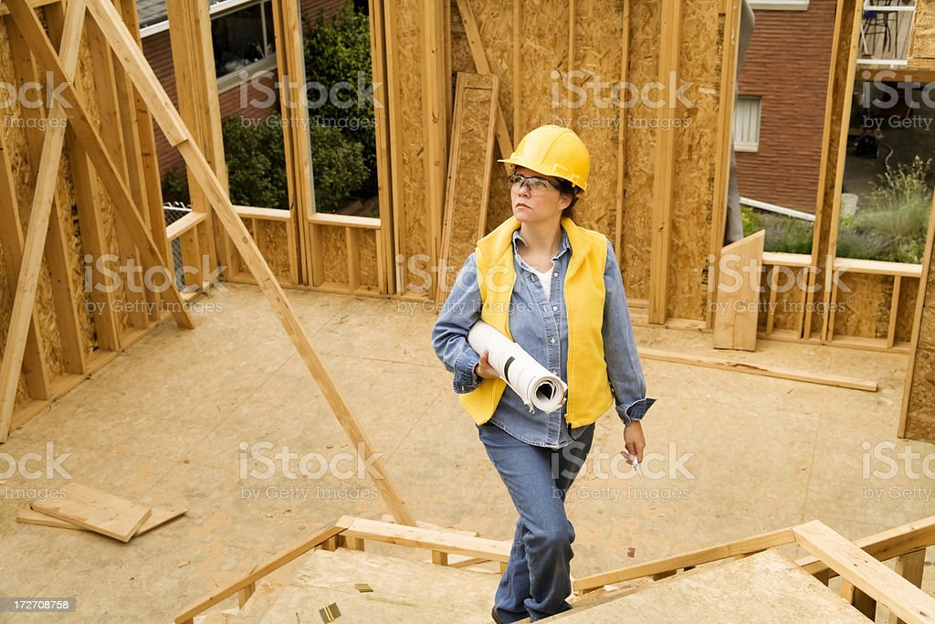 Architect Walking Through Construction Site royalty-free stock photo