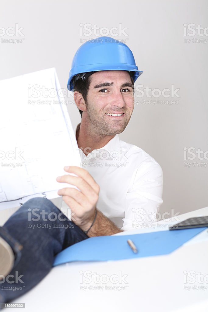 Architect with a funny look working in office royalty-free stock photo