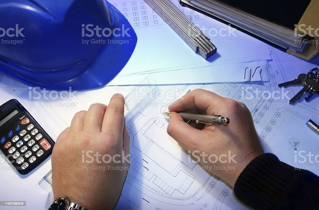 architect with a plan royalty-free stock photo