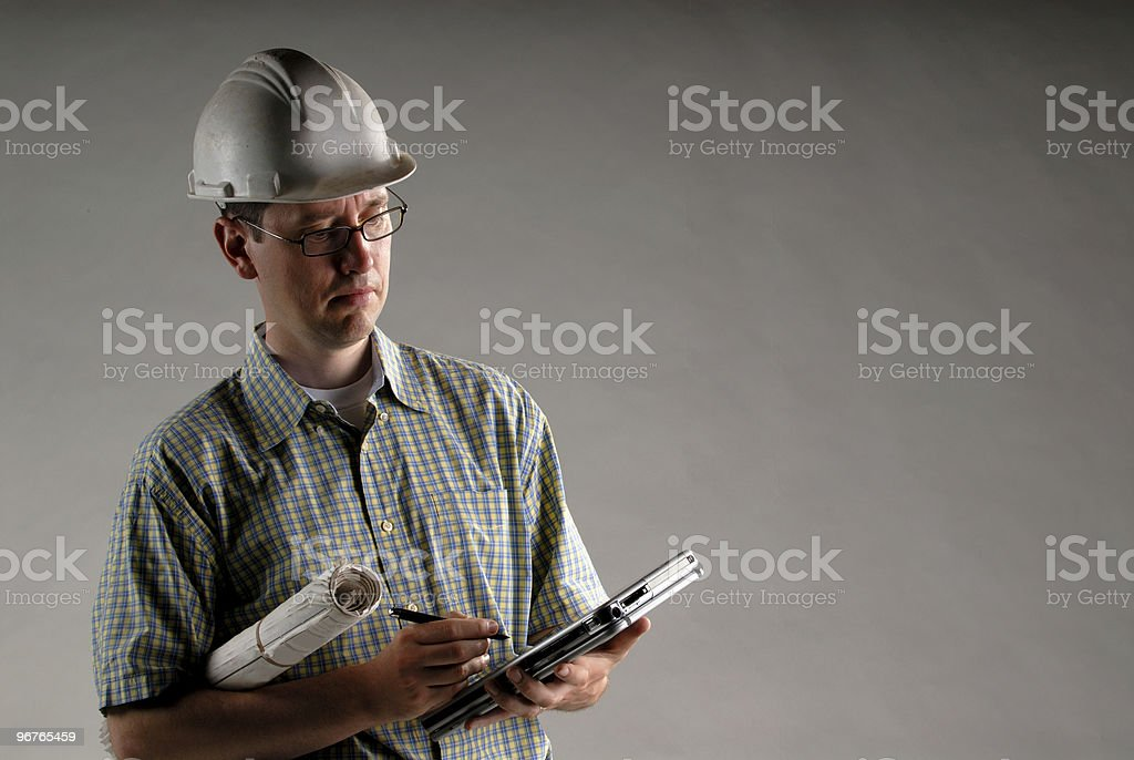 Architect With Blueprints royalty-free stock photo