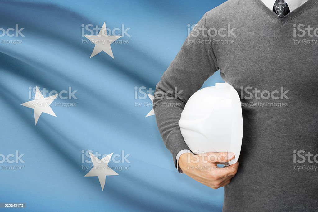 Architect with flag on background  - Federated States of Micronesia stock photo