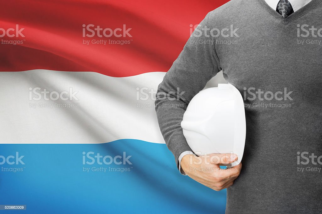 Architect with flag on background  - Luxembourg stock photo