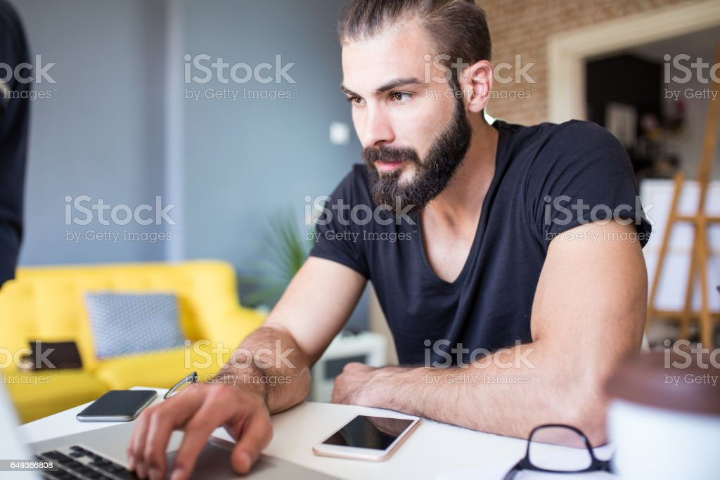 Architect working at his laptop in the office stock photo