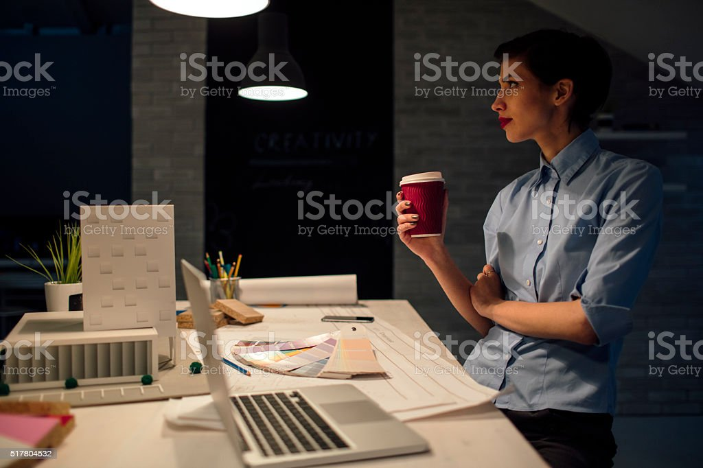 Architect Working Late In Her Office. stock photo