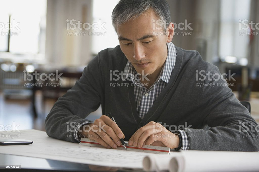 Architect working on blue prints royalty-free stock photo