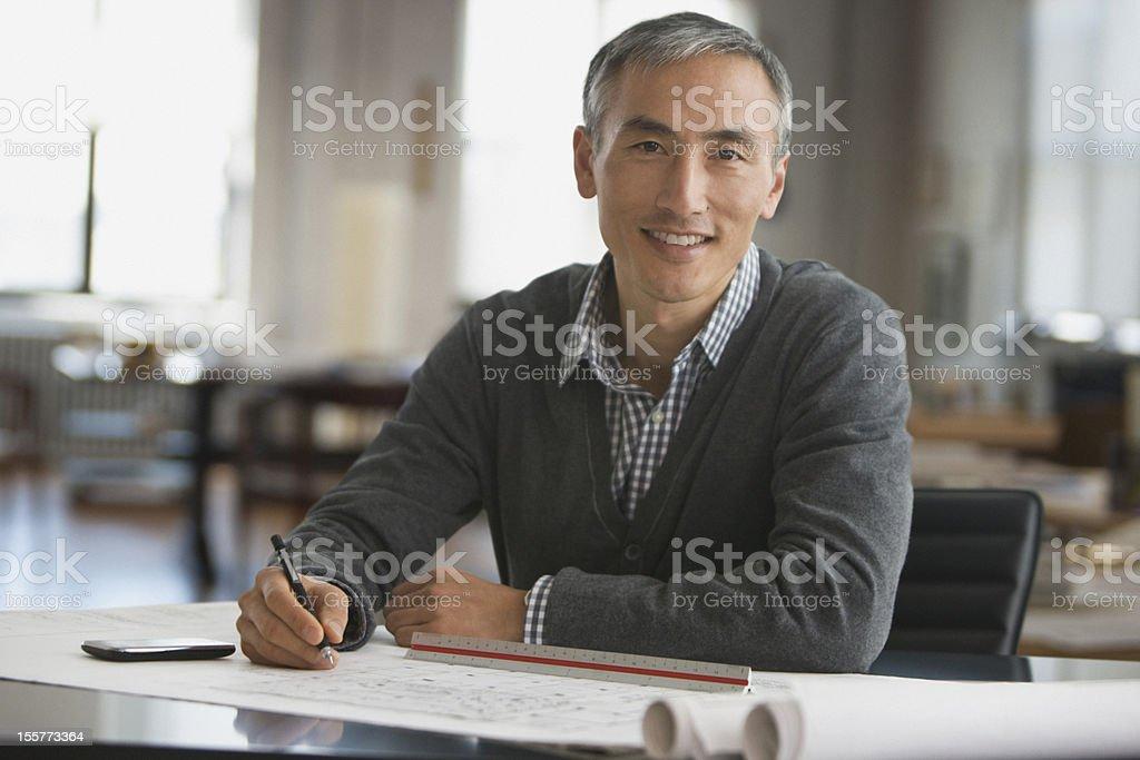 Architect working on blue prints stock photo