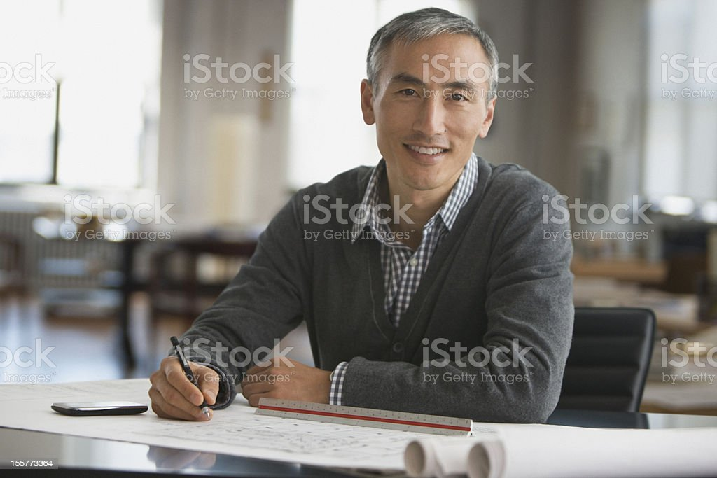 Architect working on blue prints stock photo