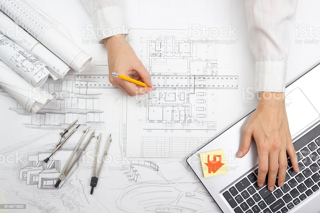 Architect working on blueprint. Architects workplace - architectural project, blueprints stock photo