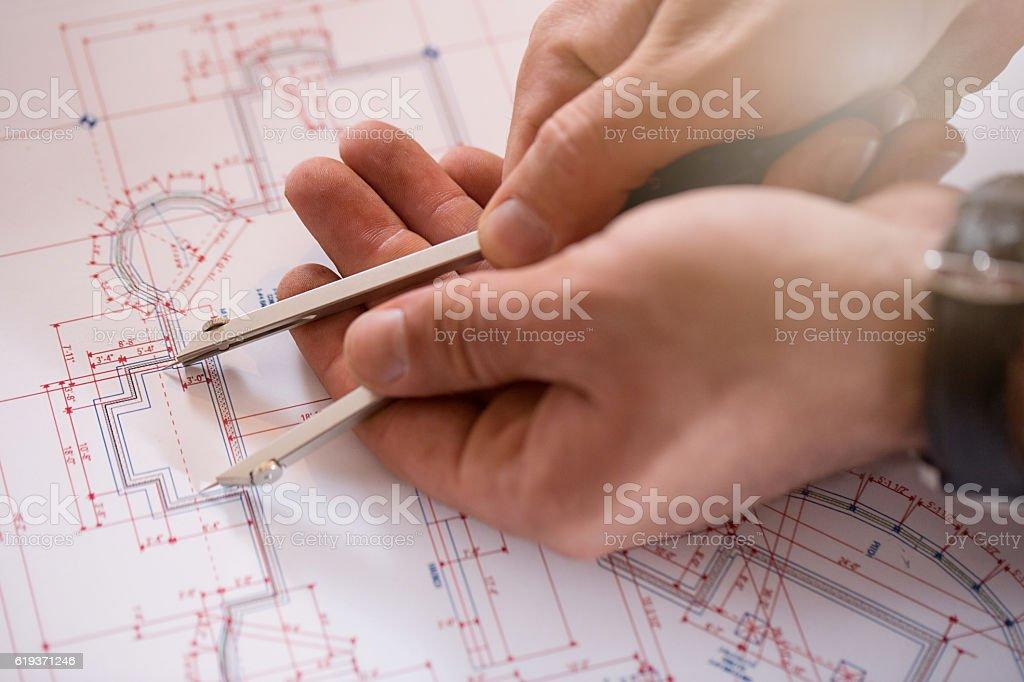 Architect working on blueprint royalty-free stock photo