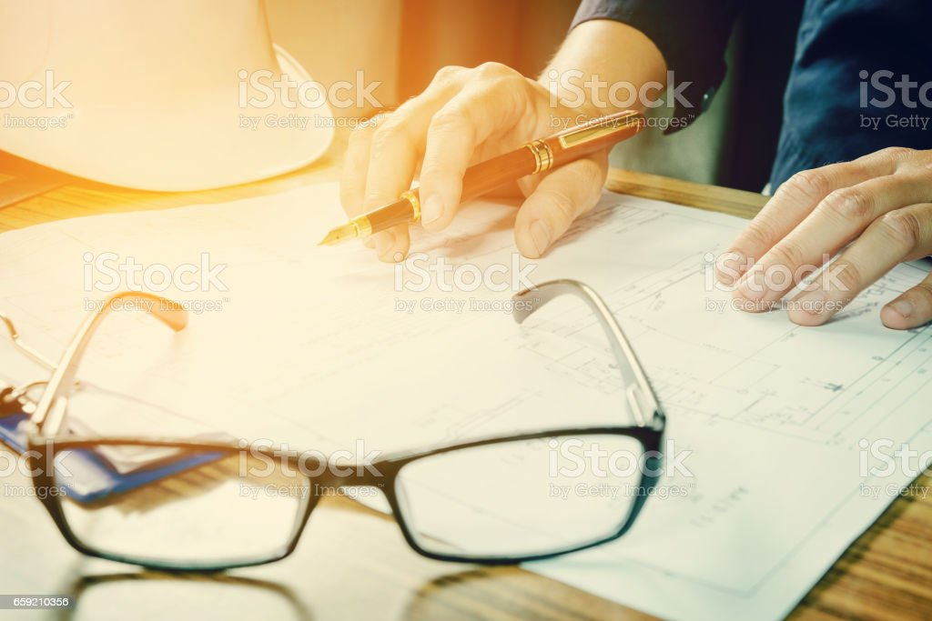 architect working on construction engineering project blueprint stock photo