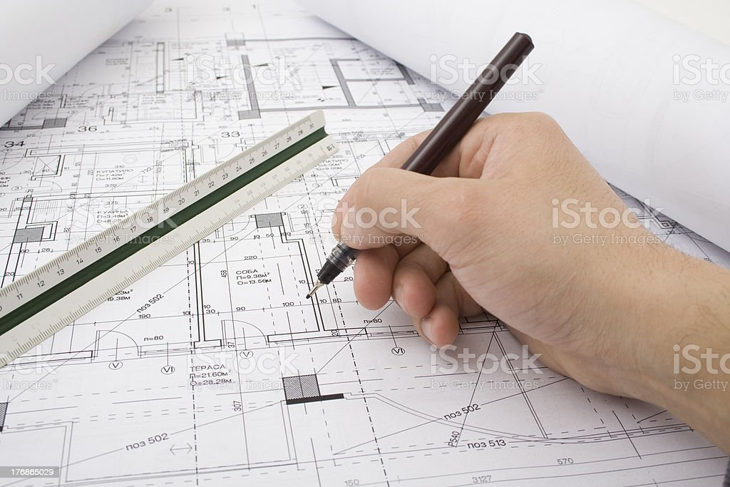Architect working on drafts close up royalty-free stock photo