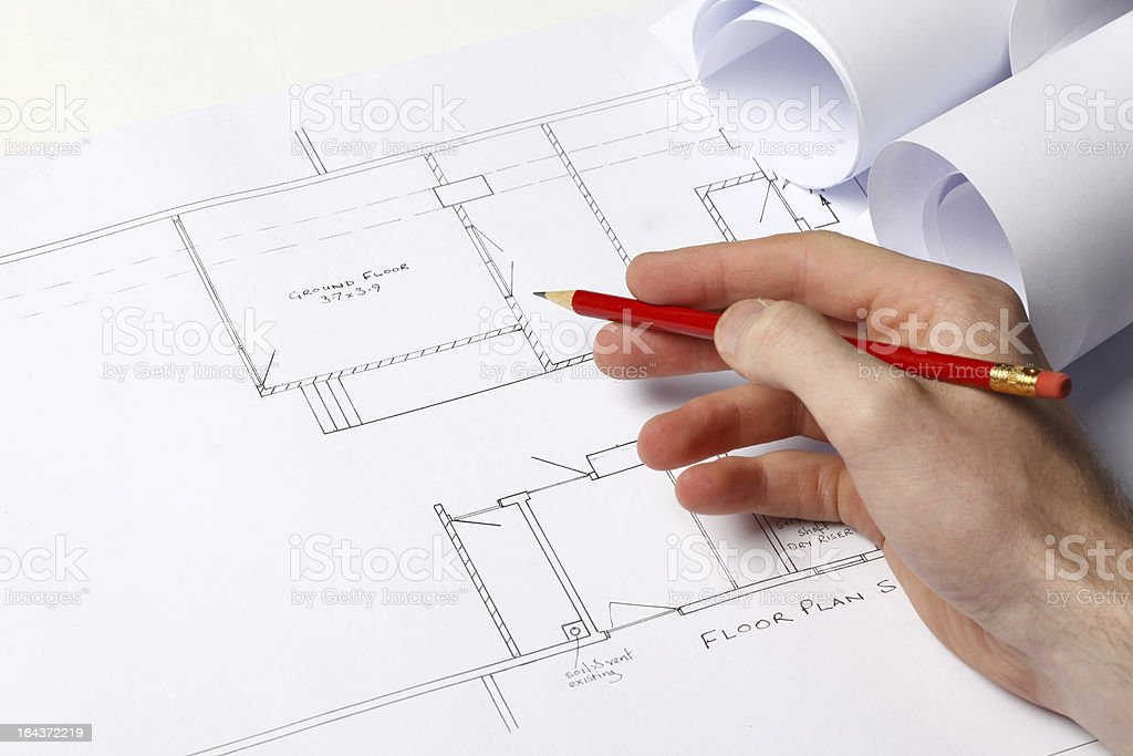 Architect working on house plans royalty-free stock photo