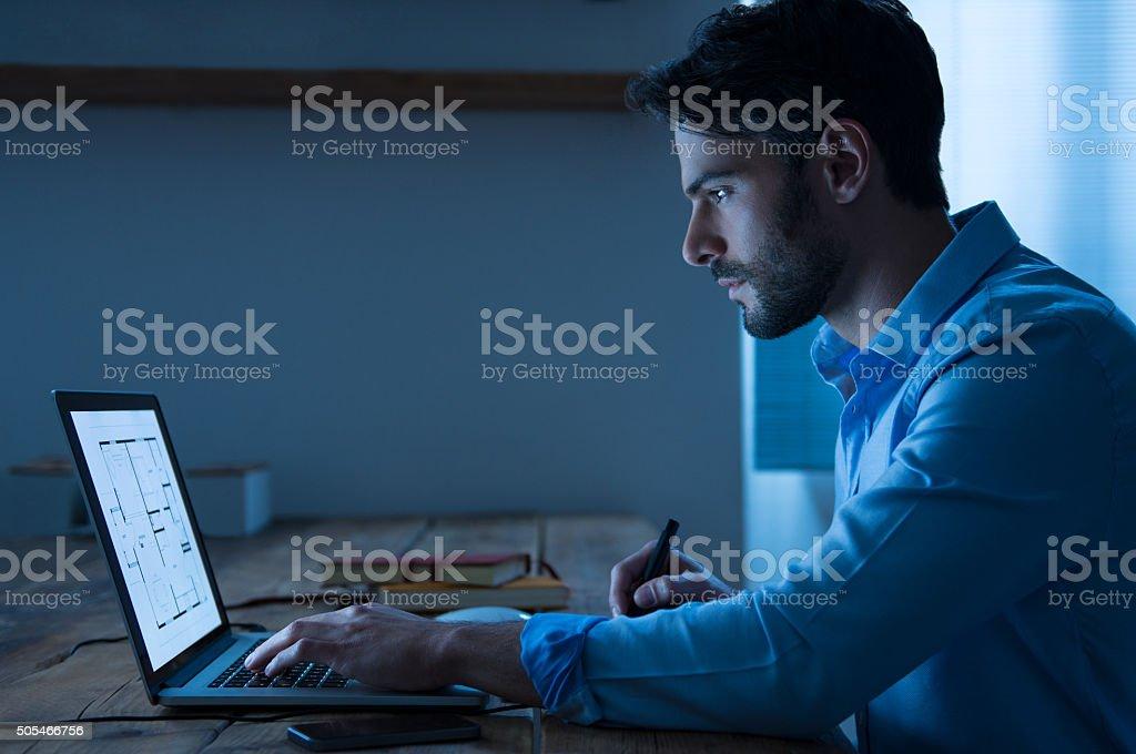 Architect working on laptop stock photo