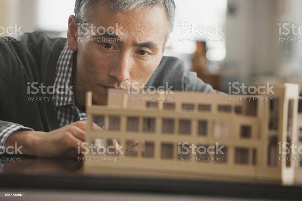 Architect working on model royalty-free stock photo
