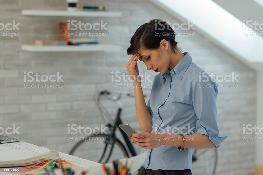 Architect Working Under Pressure In Her Office. stock photo