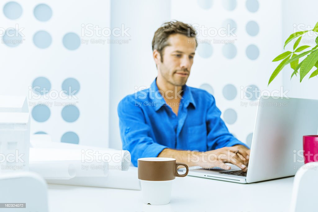 Architect working with blueprints royalty-free stock photo