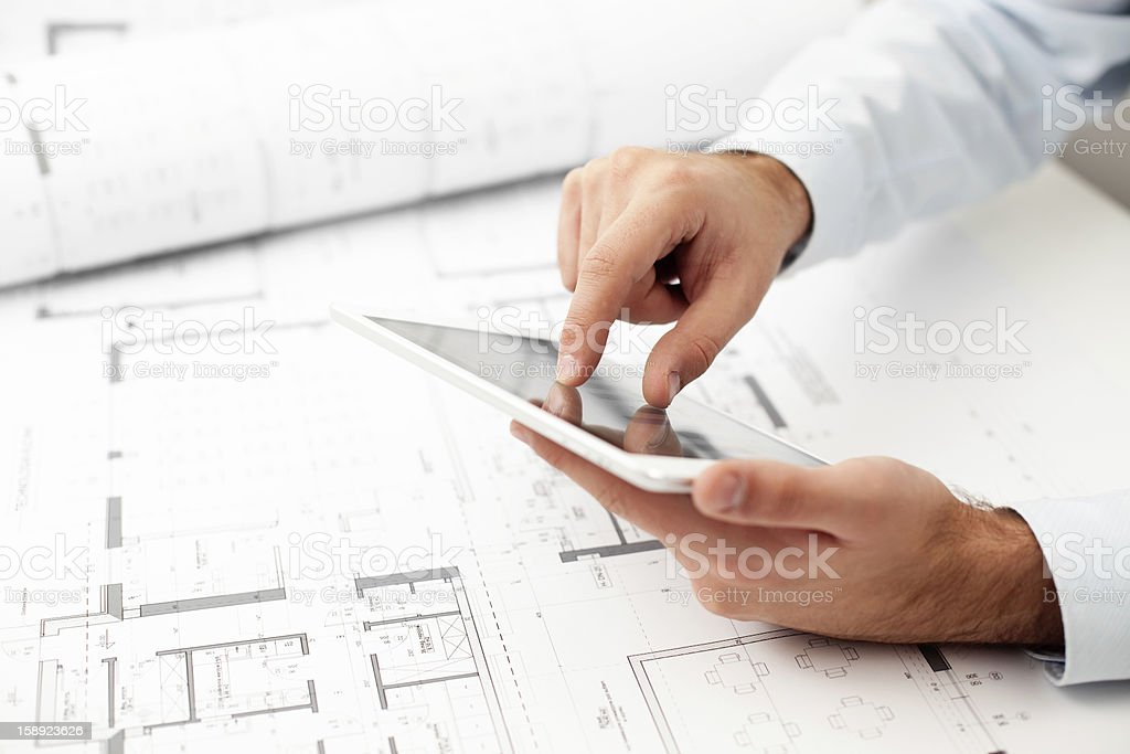 Architect working with digital tablet stock photo
