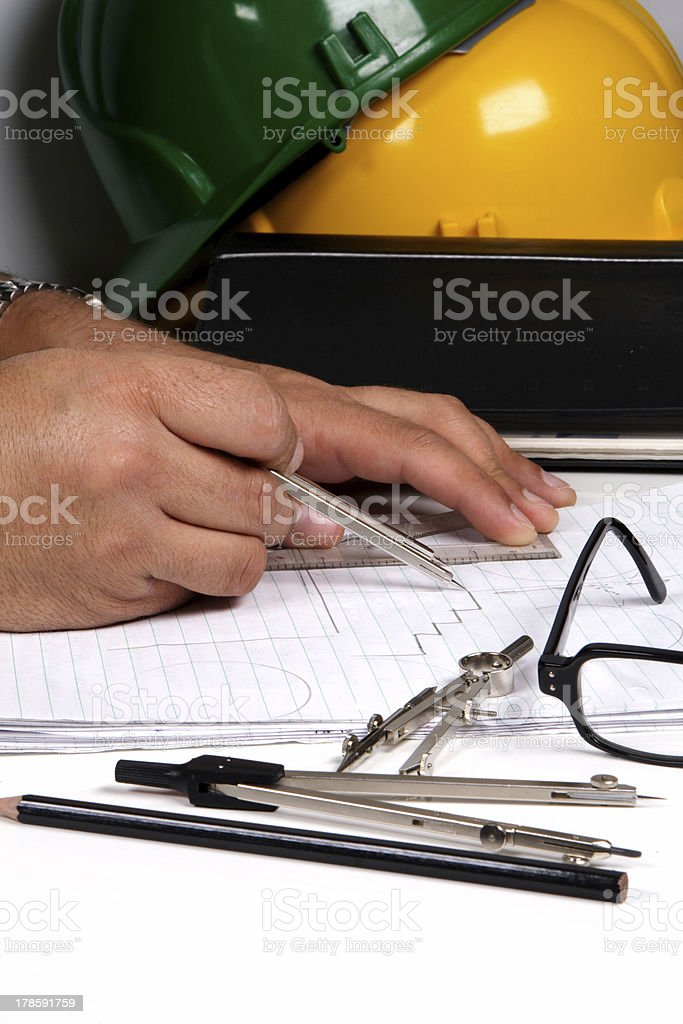 architect works on plans royalty-free stock photo