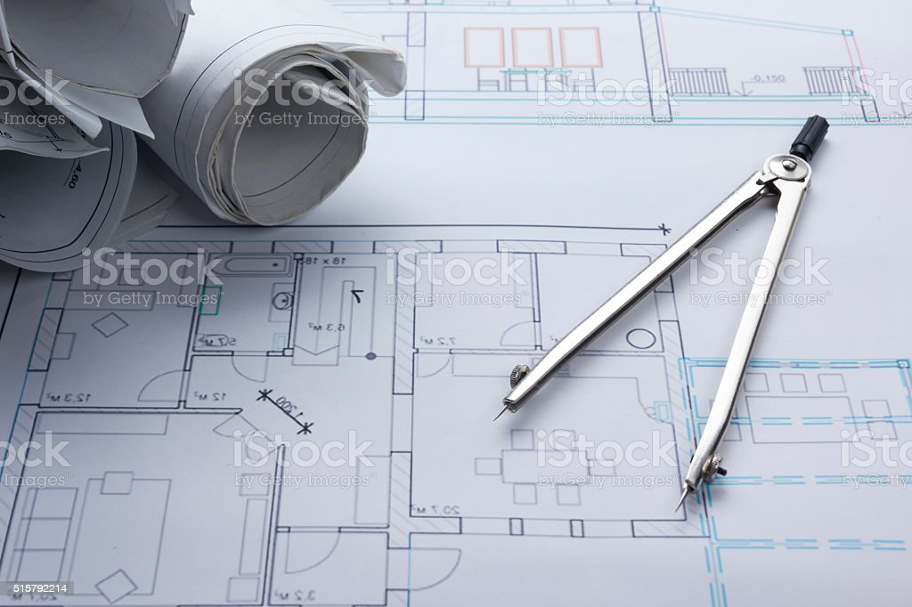 Architect worplace top view. Architectural project, blueprints, blueprint rolls and stock photo