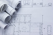 Architect worplace top view. Architectural project, blueprints, blueprint rolls on