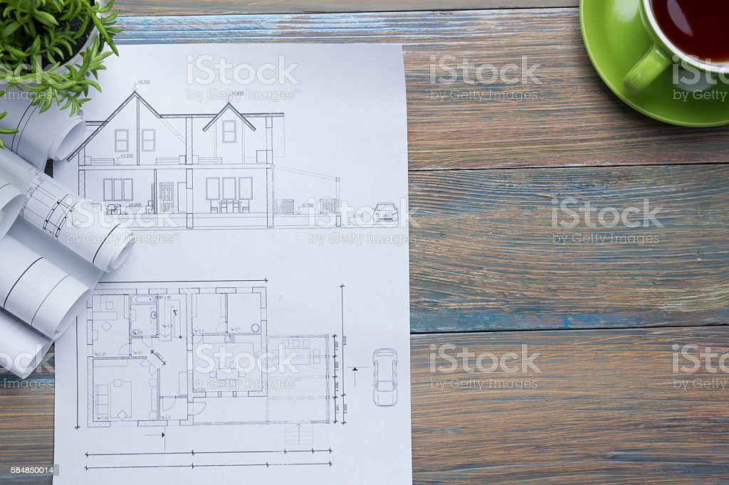 Architect worplace top view architectural project blueprints architectural project blueprints blueprint rolls and royalty free malvernweather Choice Image