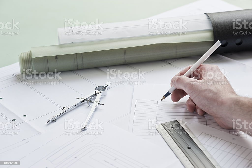 Architect Writing On The Plans royalty-free stock photo