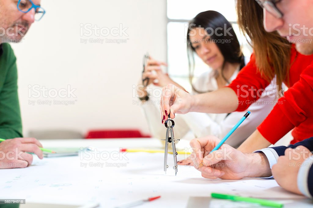 Architects and surveyors working together stock photo