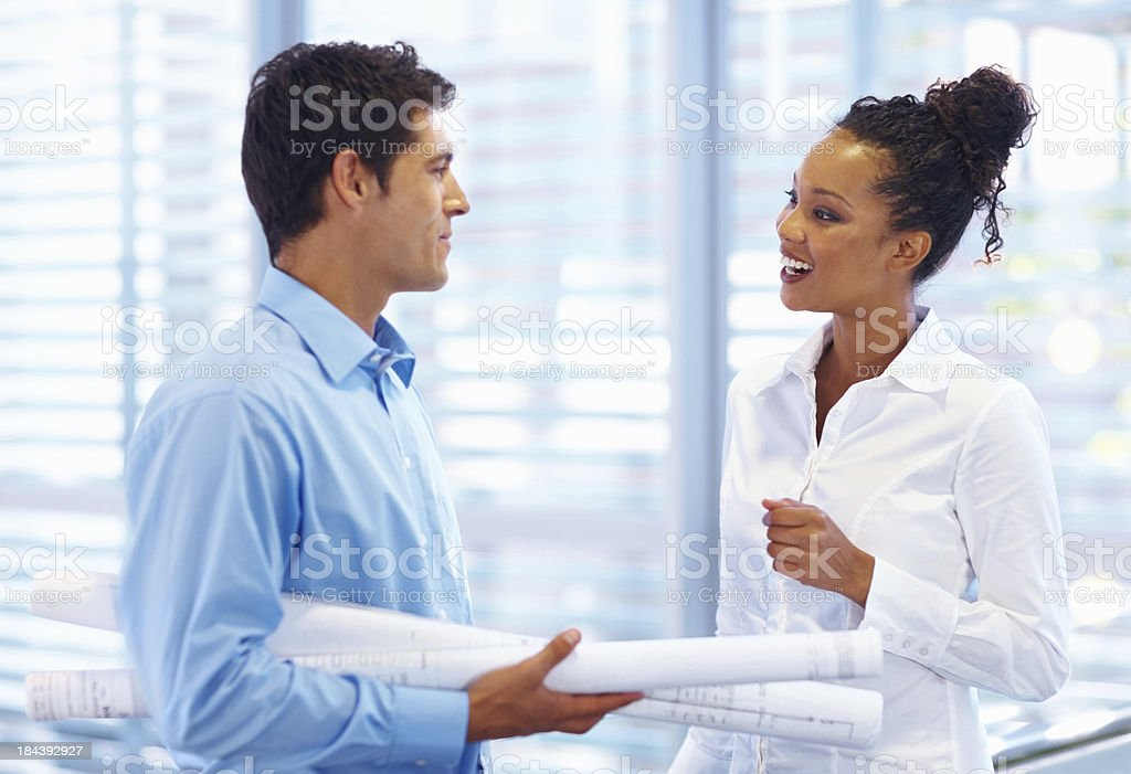 Architects conversing with each other royalty-free stock photo