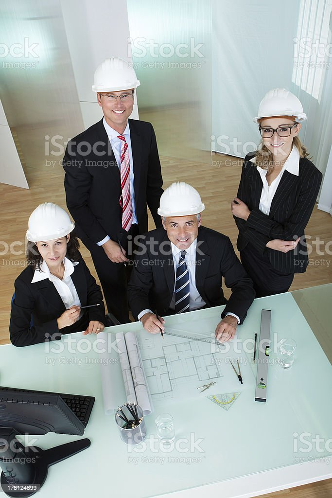 Architects discussing a blueprint royalty-free stock photo