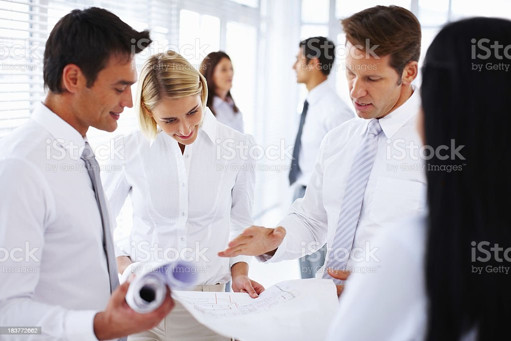 Architects discussing plans royalty-free stock photo