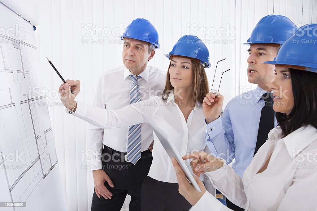 Architects Discussing Project royalty-free stock photo
