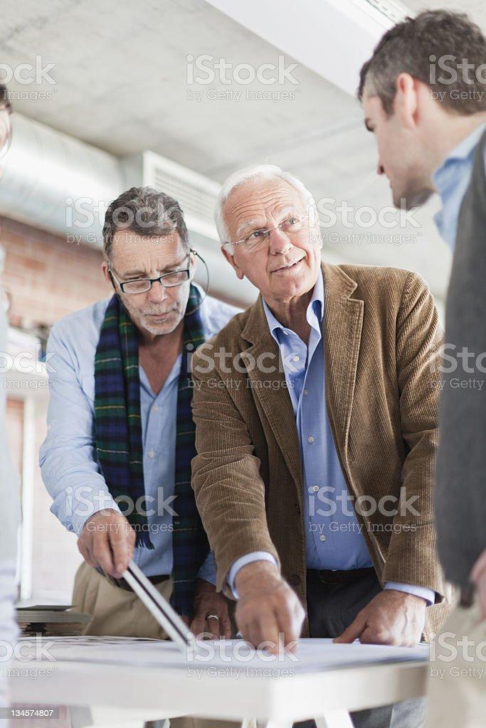 Architects examining blueprints stock photo