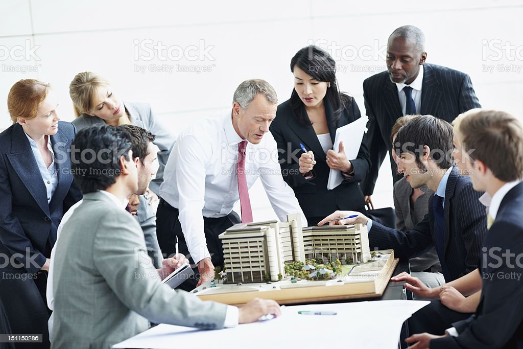 Architects examining building model royalty-free stock photo