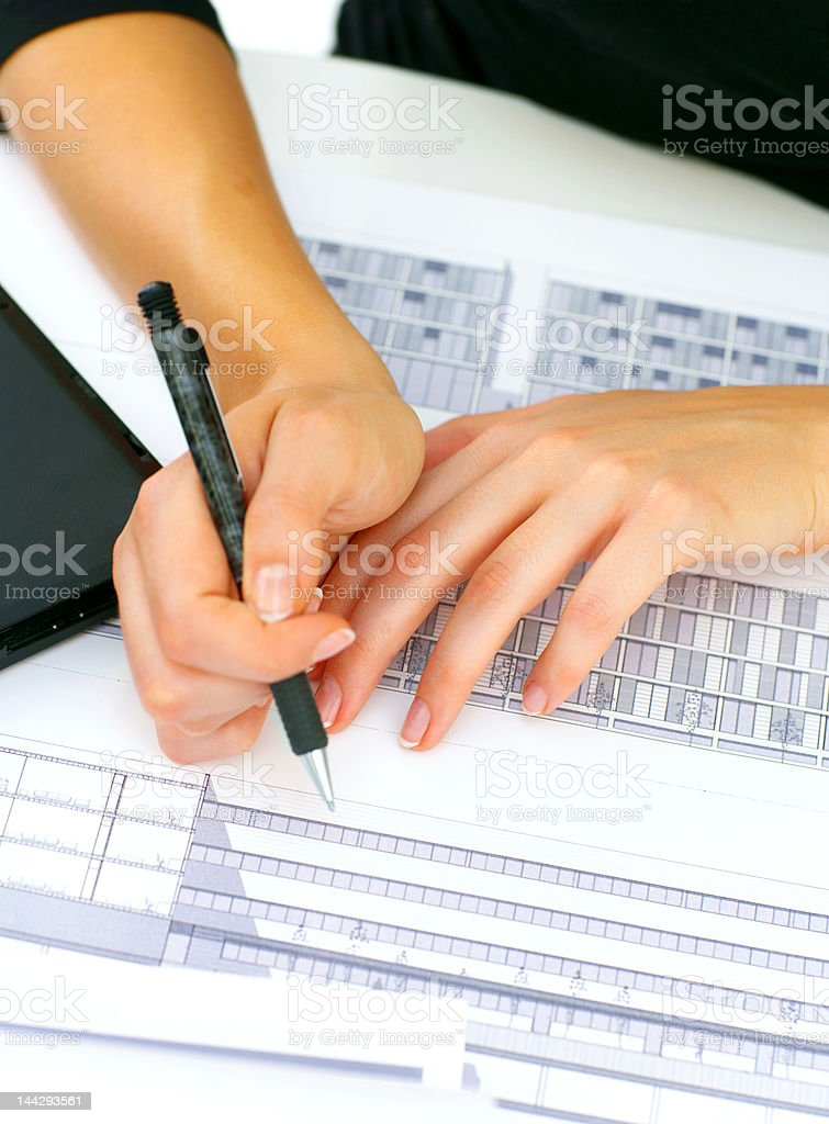 Architect's hands on top of some blueprints royalty-free stock photo