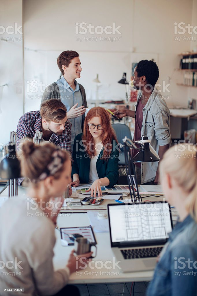 Architects in office working together stock photo