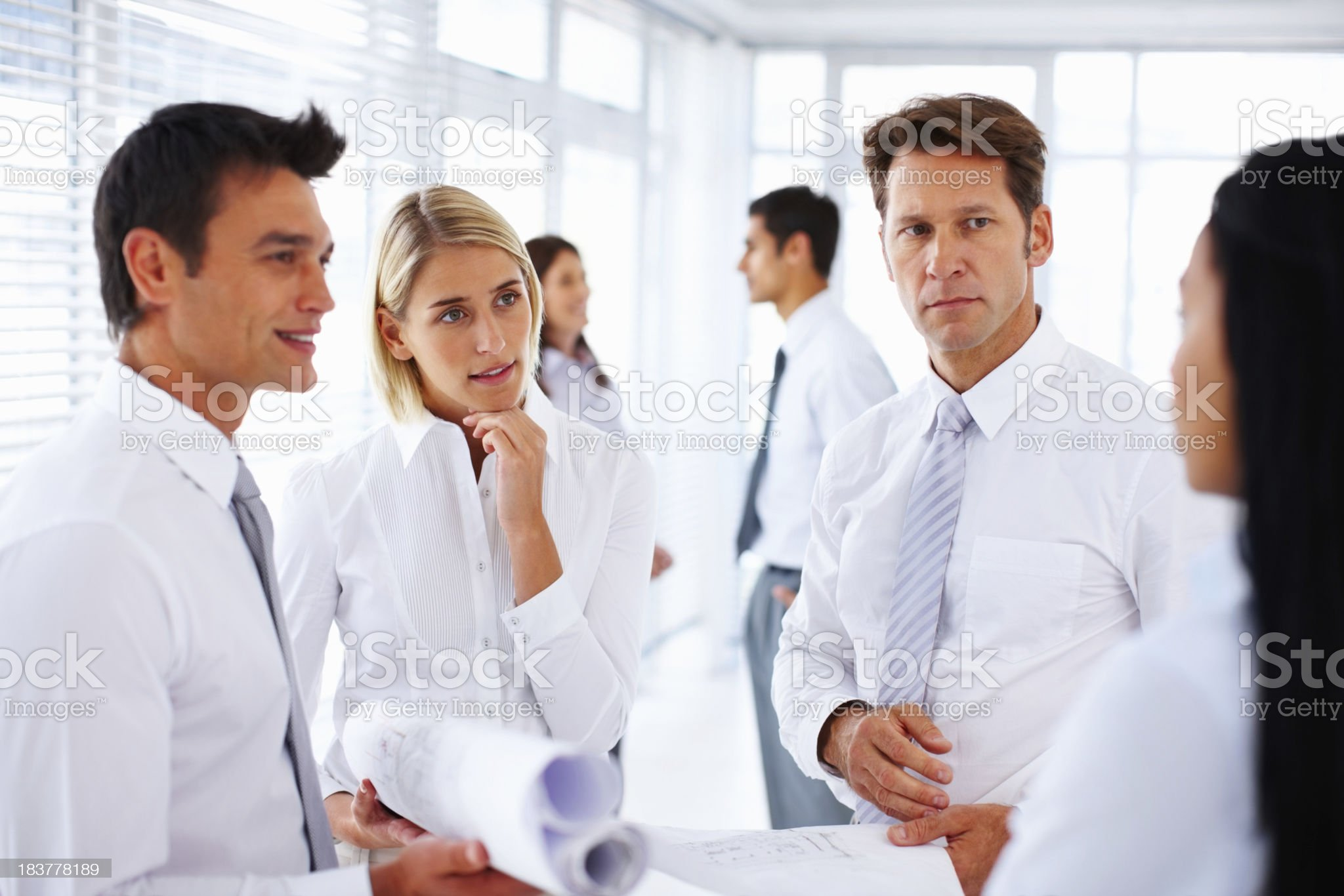 Architects in serious discussion royalty-free stock photo