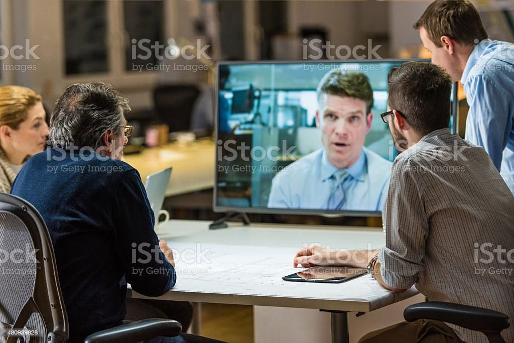 Architects in video conference stock photo