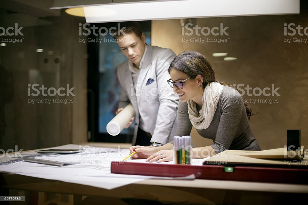 Architects looking at new  project in studio stock photo