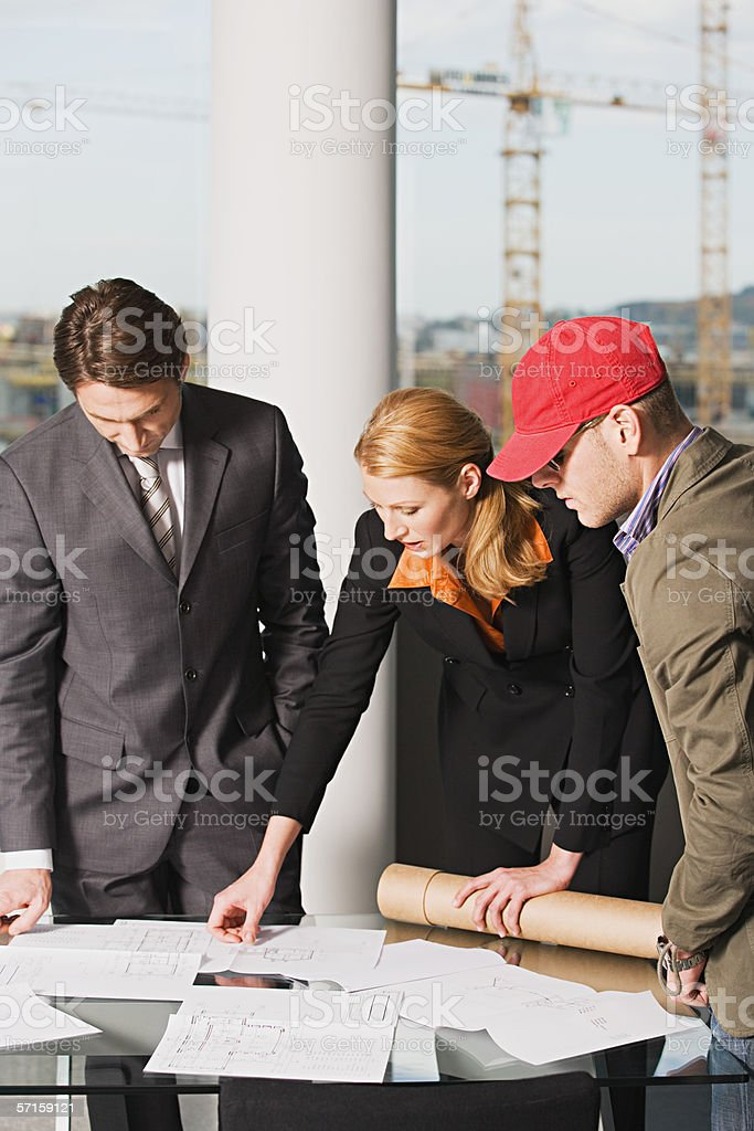 Architects looking at plans royalty-free stock photo