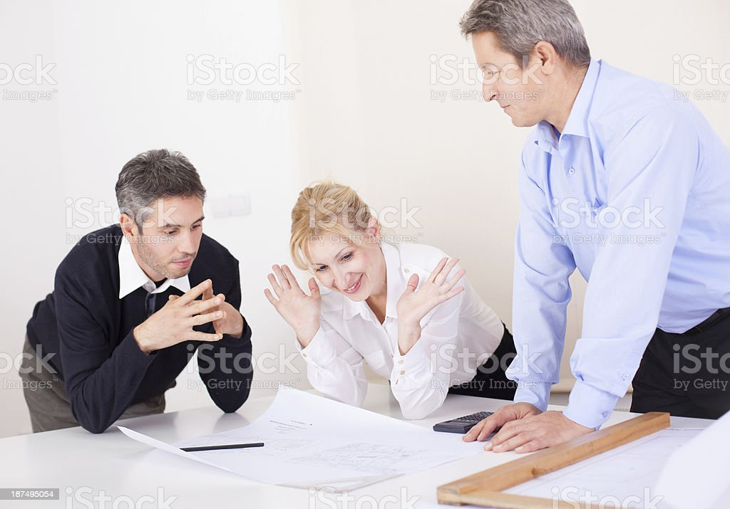 Architects looking at the plan royalty-free stock photo