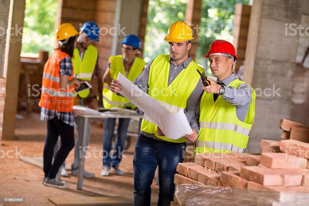 Architects planning together future building stock photo
