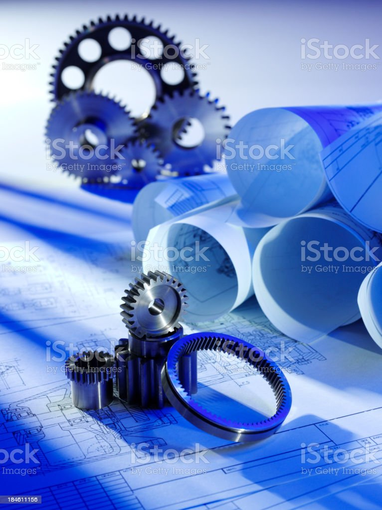 Architects Plans with Gears and Cogs royalty-free stock photo