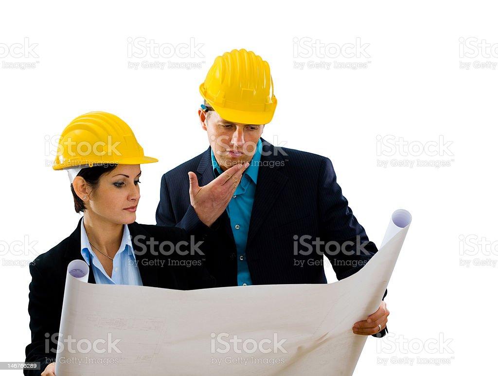 Architects reading blueprint royalty-free stock photo