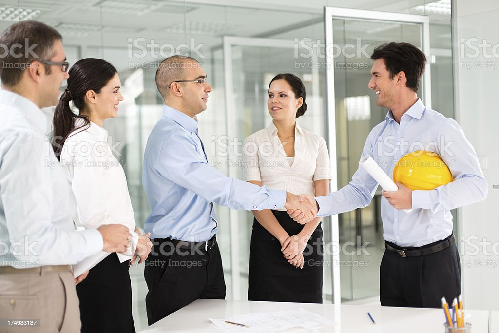 Architects shaking hands royalty-free stock photo