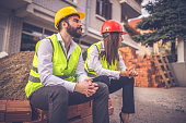 Architects sitting in front of a construction site