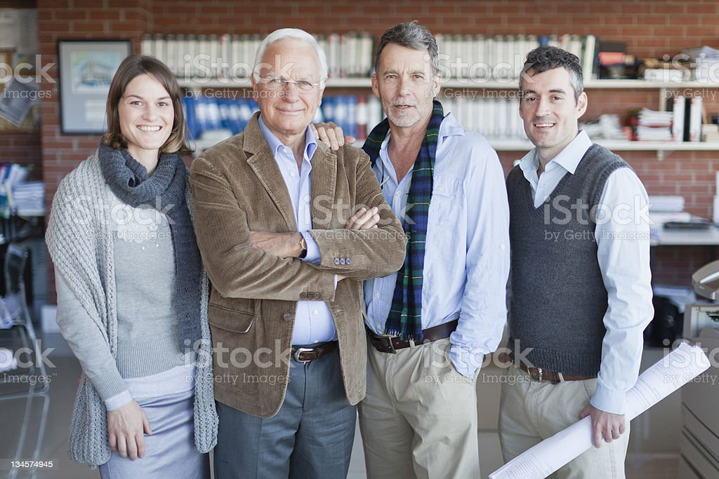 Architects smiling together in office stock photo