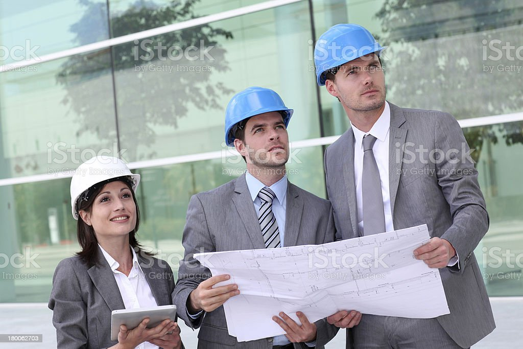 Architects team with helmets on construction site royalty-free stock photo