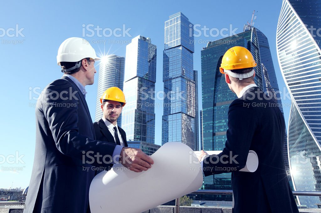 Architects with blueprint stock photo