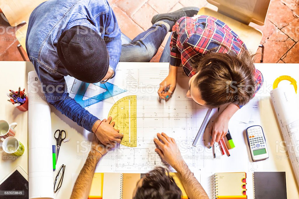 Architects working on a blueprint stock photo