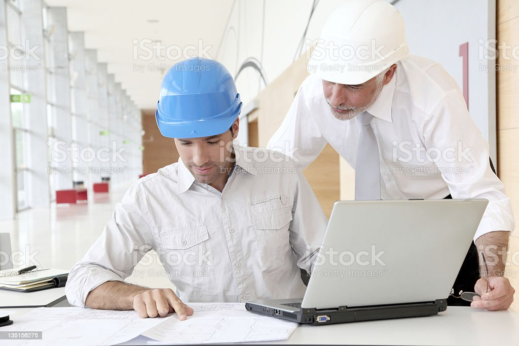 Architects working on construction plan royalty-free stock photo